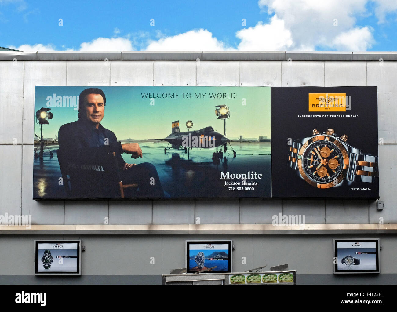 An advertisement for Breitling watches with a photo of John Travolta in Jackson Heights, Queens, New York. - Stock Image