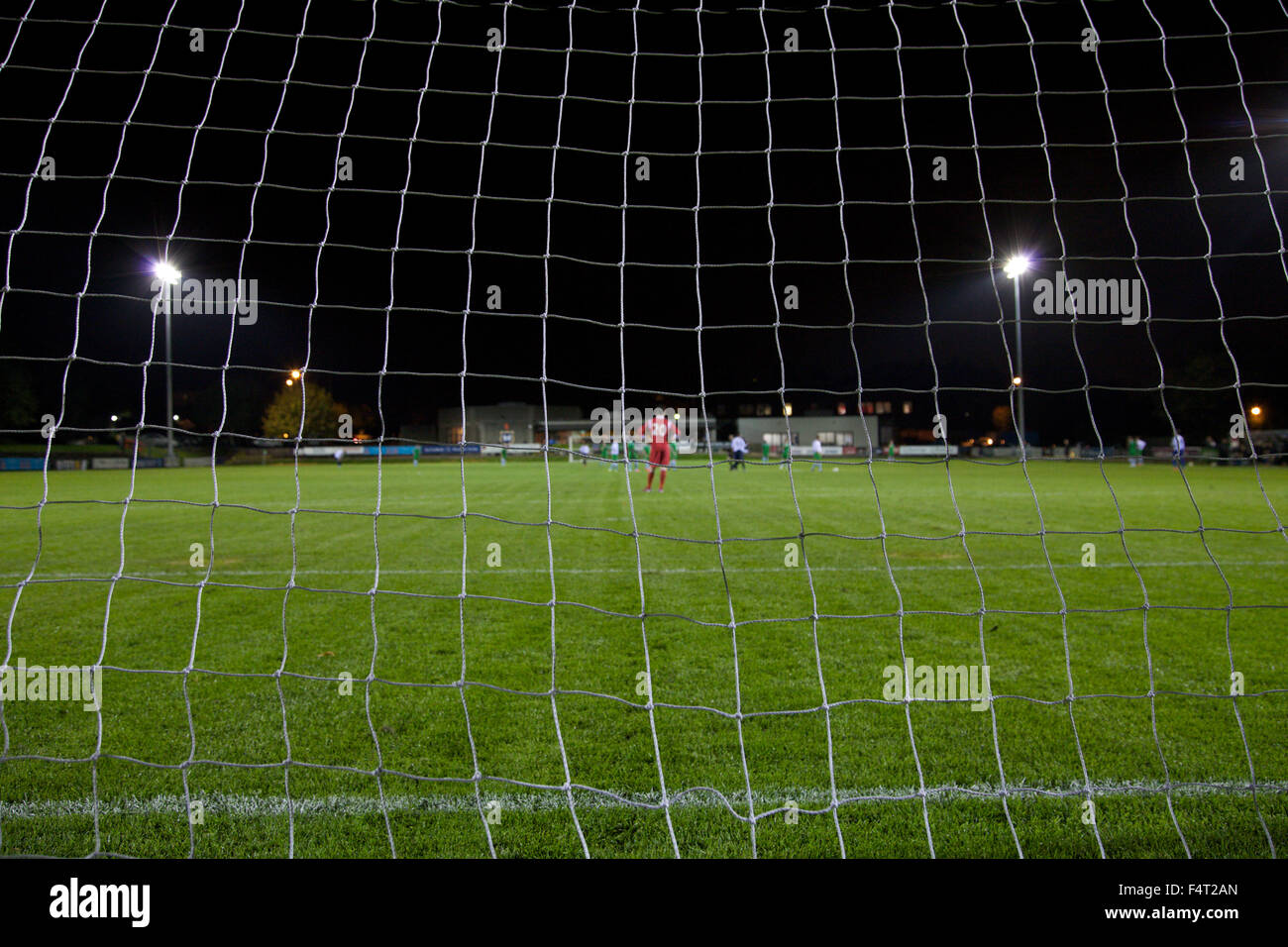 View of football pitch from behind the goal. - Stock Image