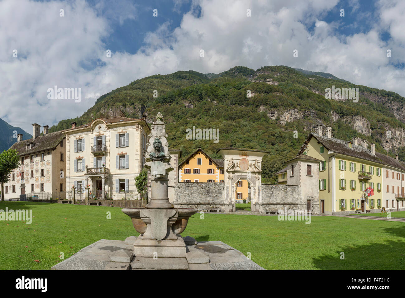 Switzerland, Europe, Cevio, Ticino, Lawn, square, well, Maggia valley, city, village, field, meadow, summer, mountains, - Stock Image