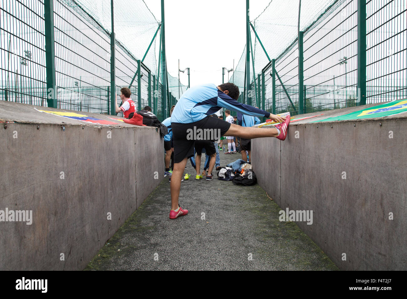 A footballer warming up to play 5 a side football. - Stock Image