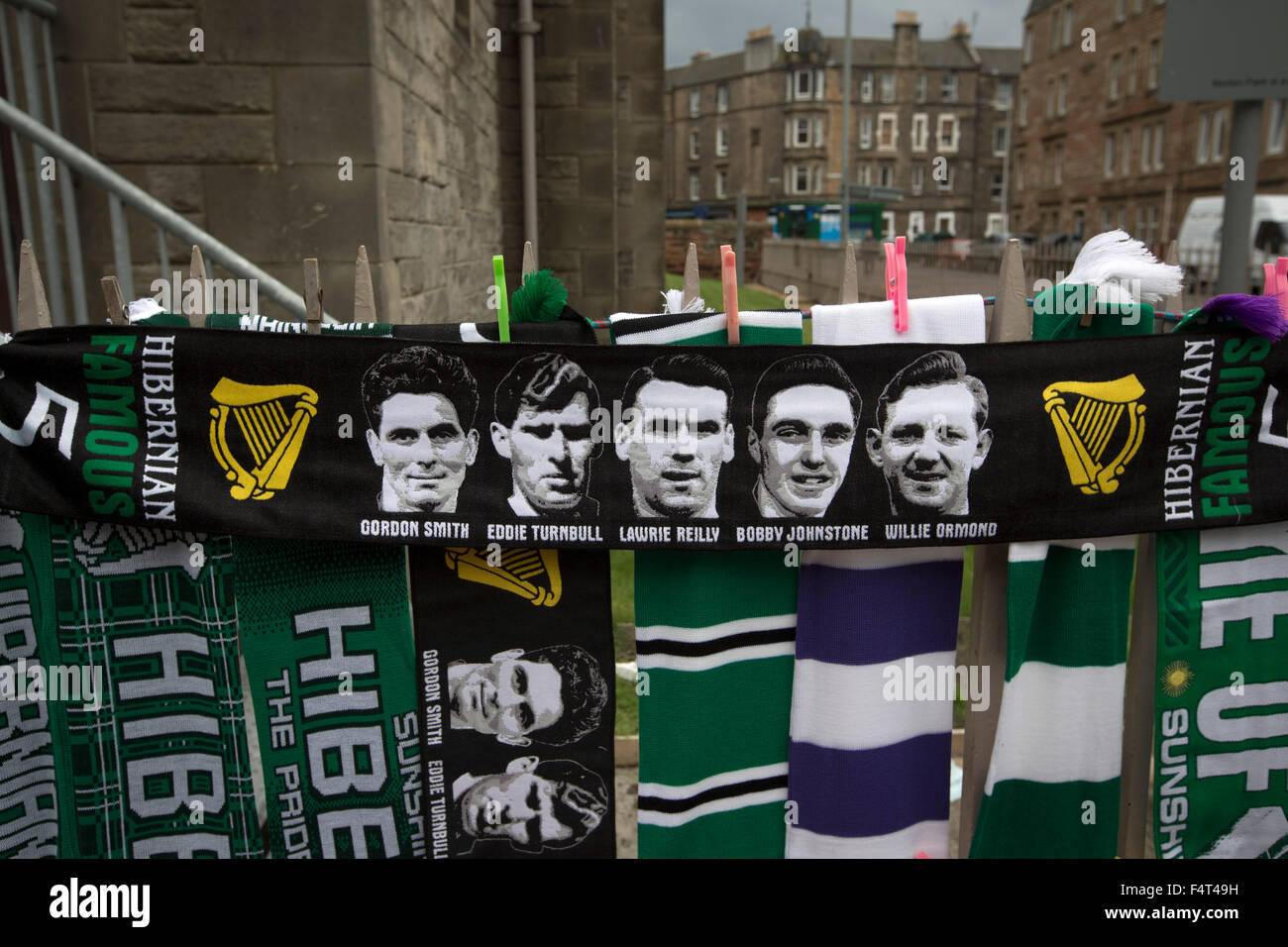 A display of scarves, one featuring the 1950s heroes known as the Famous Five on sale next to Easter Road stadium - Stock Image