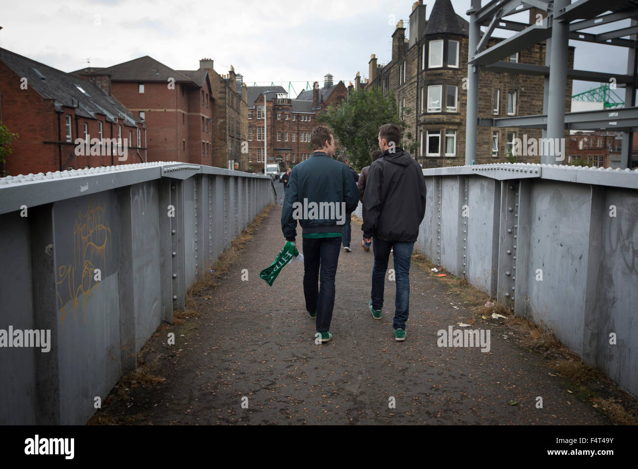 Home fans walking over the famous Crawford Bridge on their way to  Easter Road stadium before the Scottish Championship - Stock Image