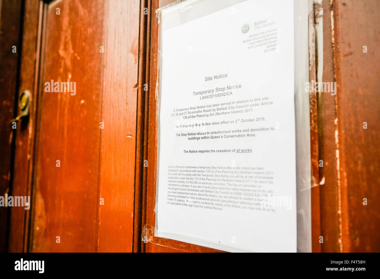 'Stop notice' served on a building under protection from being demolished, within the Queens University - Stock Image