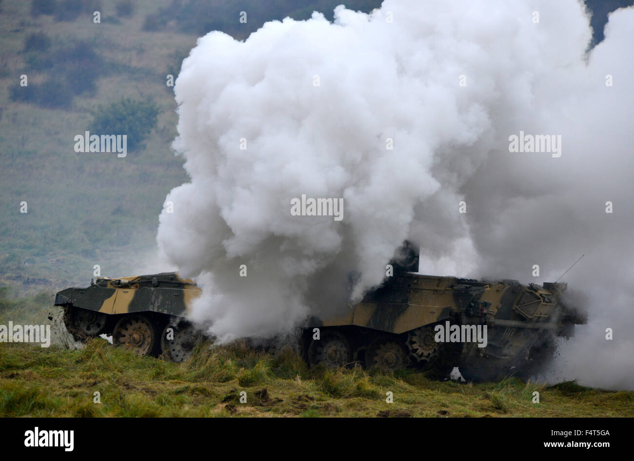 British Army Fire Power demonstration on Salisbury Plain. Challenger tank makes smoke to make a tactical withdraw - Stock Image