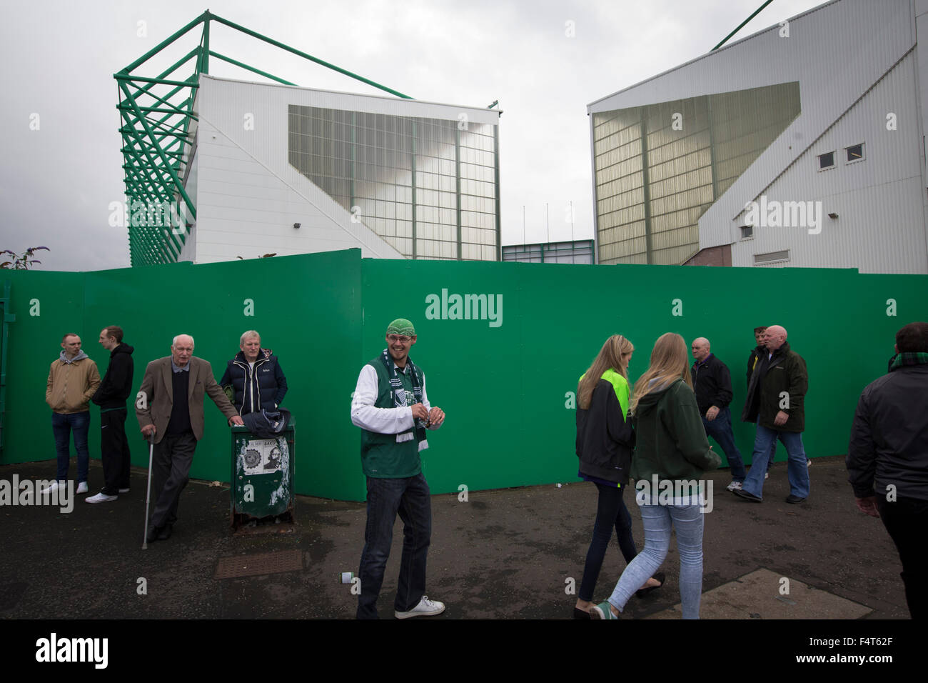 Fans making their way past the Famous Five Stand (right) and the East Stand at Easter Road stadium before the Scottish - Stock Image