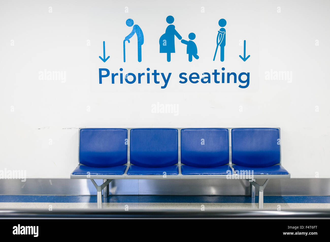Priority seating  at an airport for elderly, pregnant ladies or people with disabilities. - Stock Image