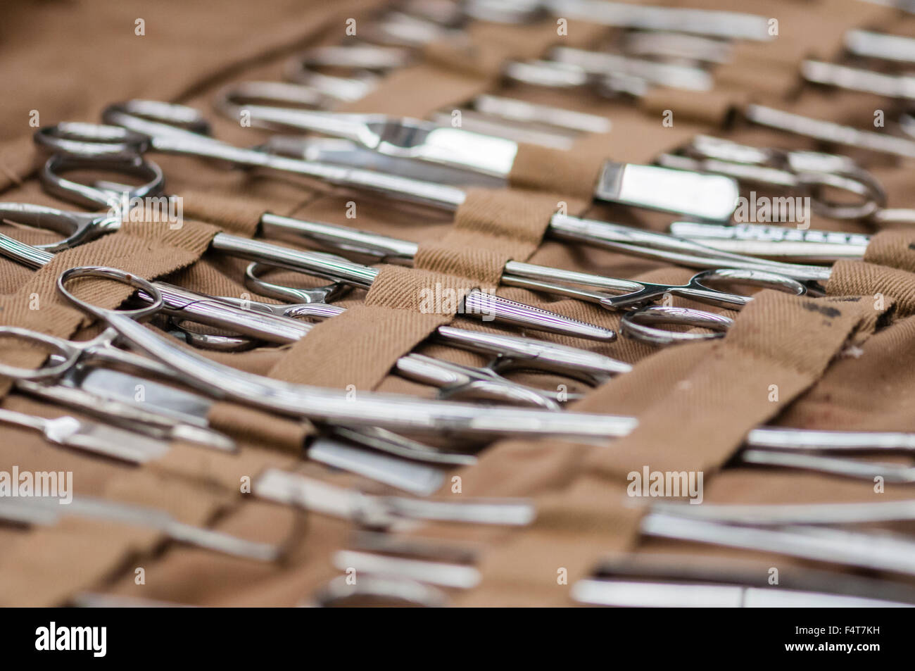 Large selection of stainless steel surgical equipment, including Magill and artery forceps, tweezers, retractors - Stock Image