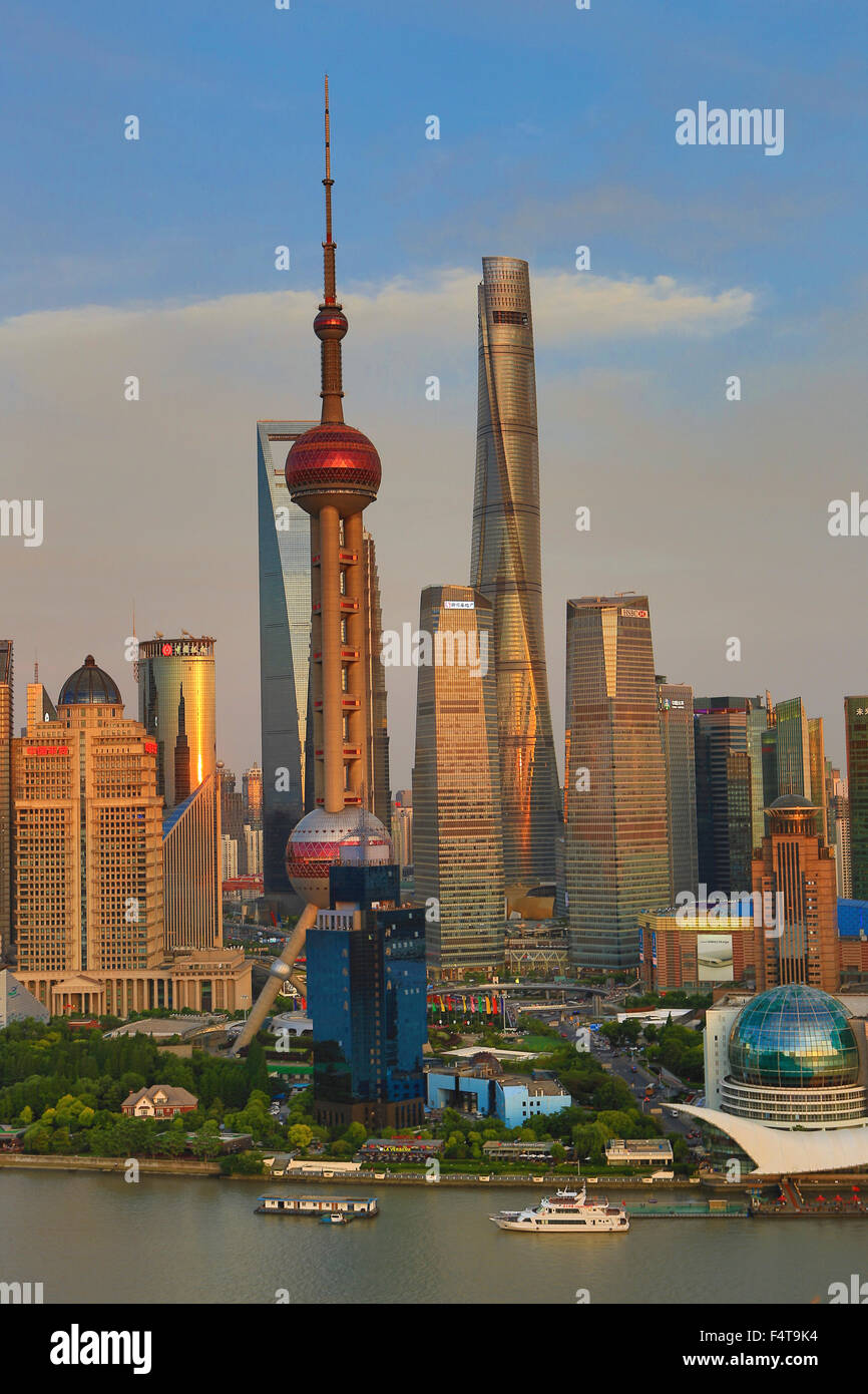 China, Shanghai City, Pudong Skyline, Oriental Pearl, World Financial Center and Shanghai Towers, Huangpu River. - Stock Image