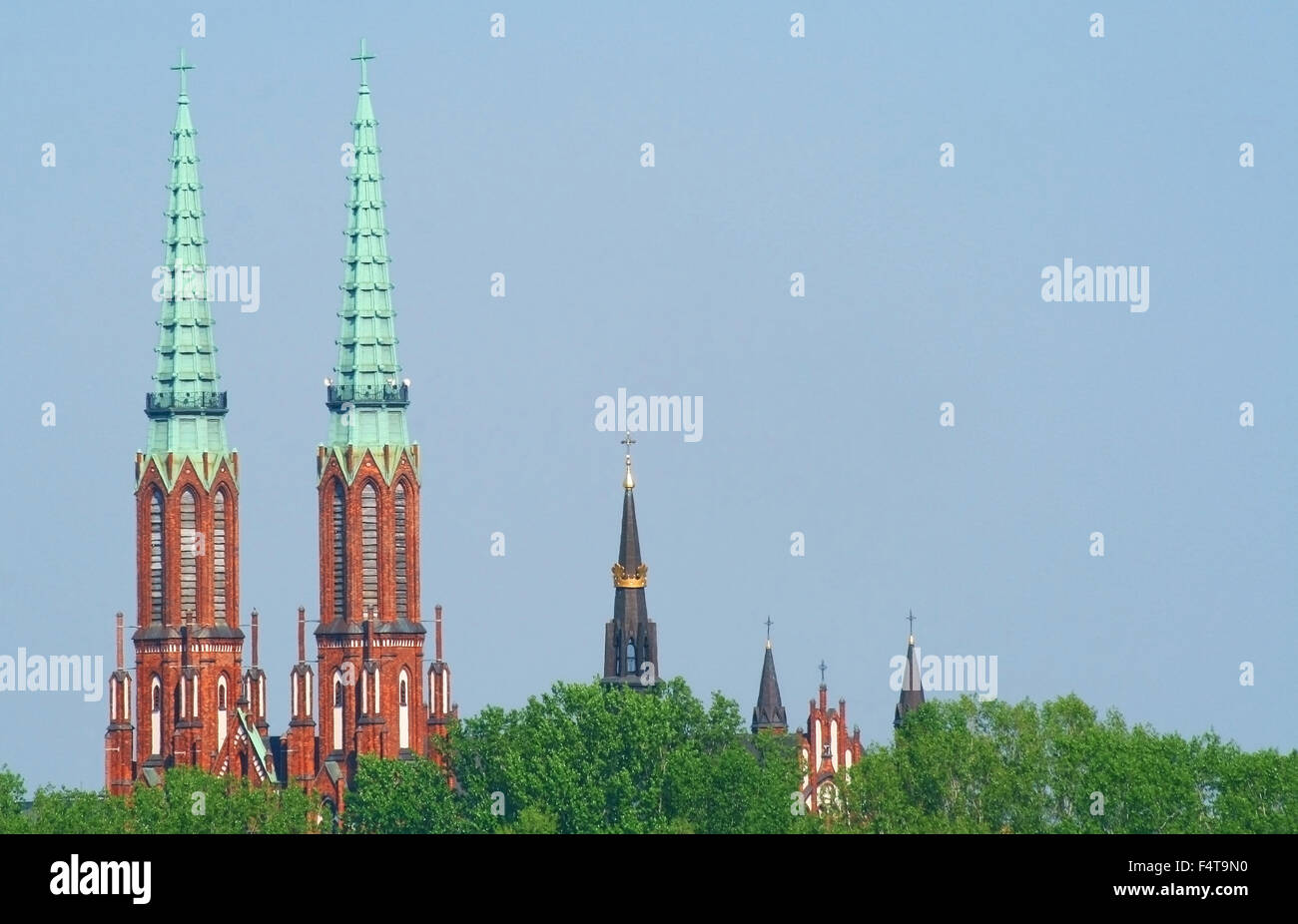 Towers of churches located in Praga district in Warsaw seen from left bank of vistula river. - Stock Image
