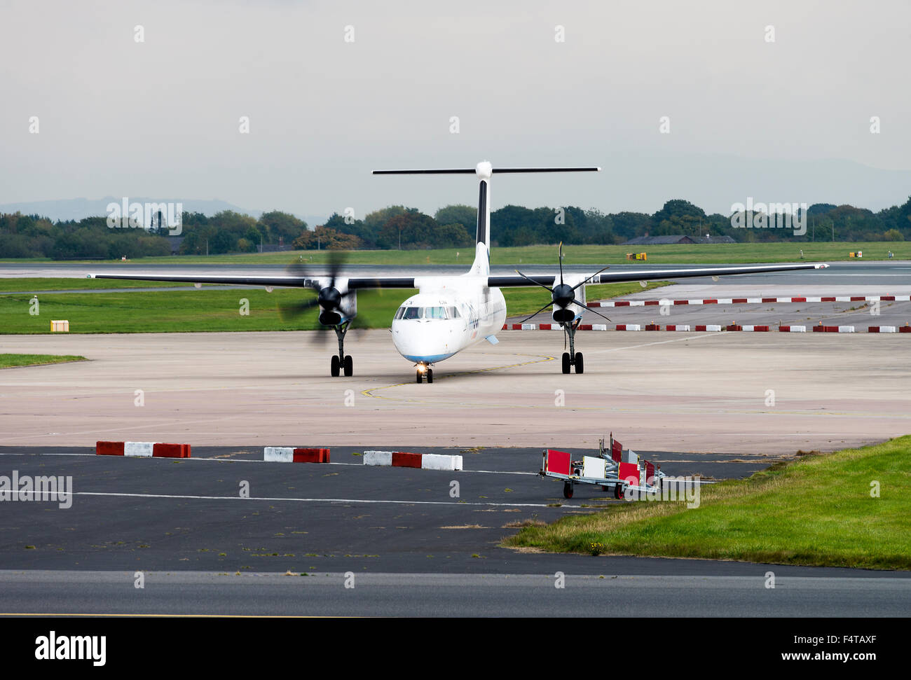 Flybe Airlines Bombardier Dash8-402Q Turboprop Airliner G-JECN Taxiing at Manchester Airport England United Kingdom Stock Photo