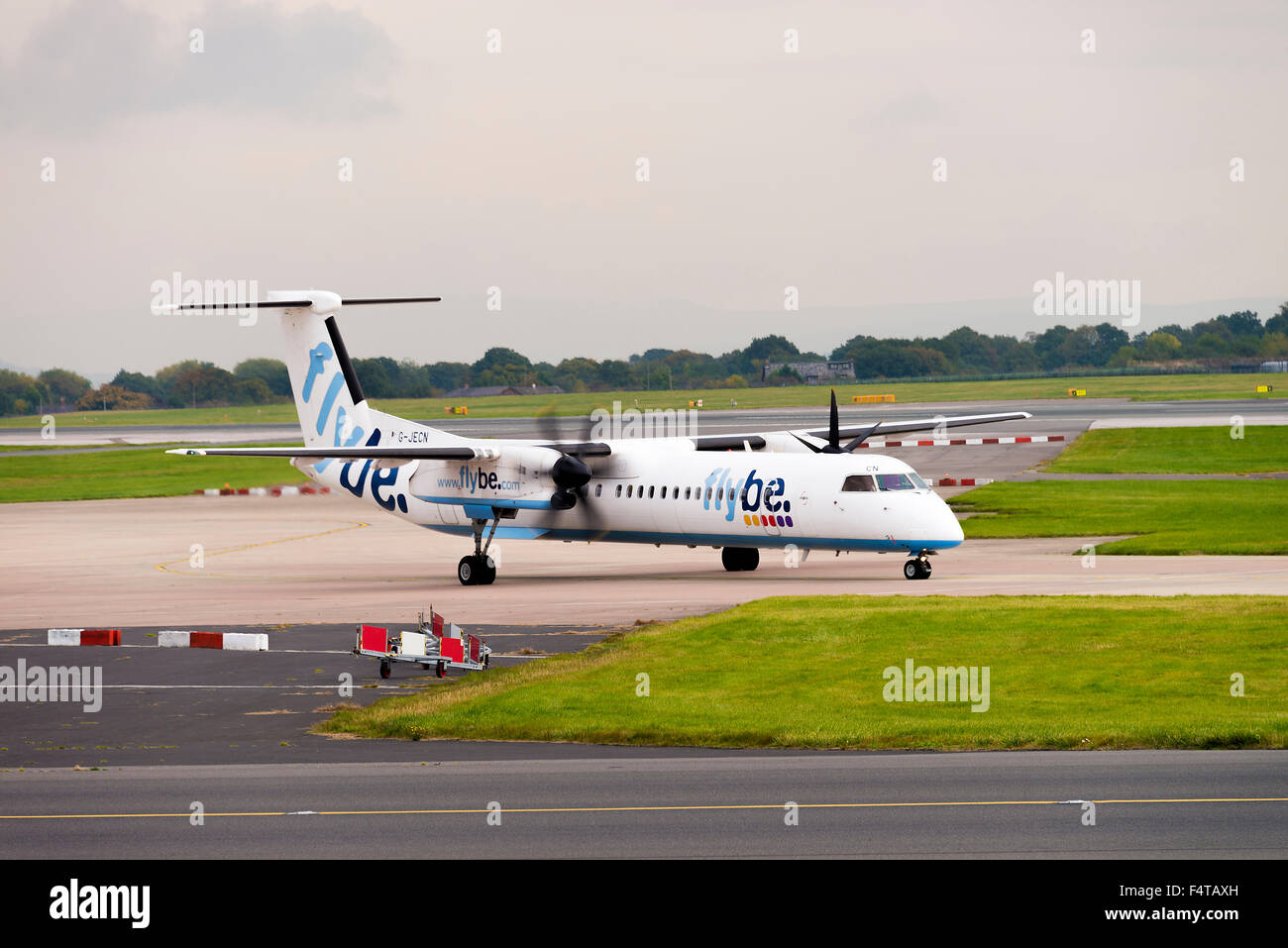 Flybe Airlines Bombardier Dash8-402Q Turboprop Airliner G-JECN Taxiing at Manchester Airport England United Kingdom - Stock Image