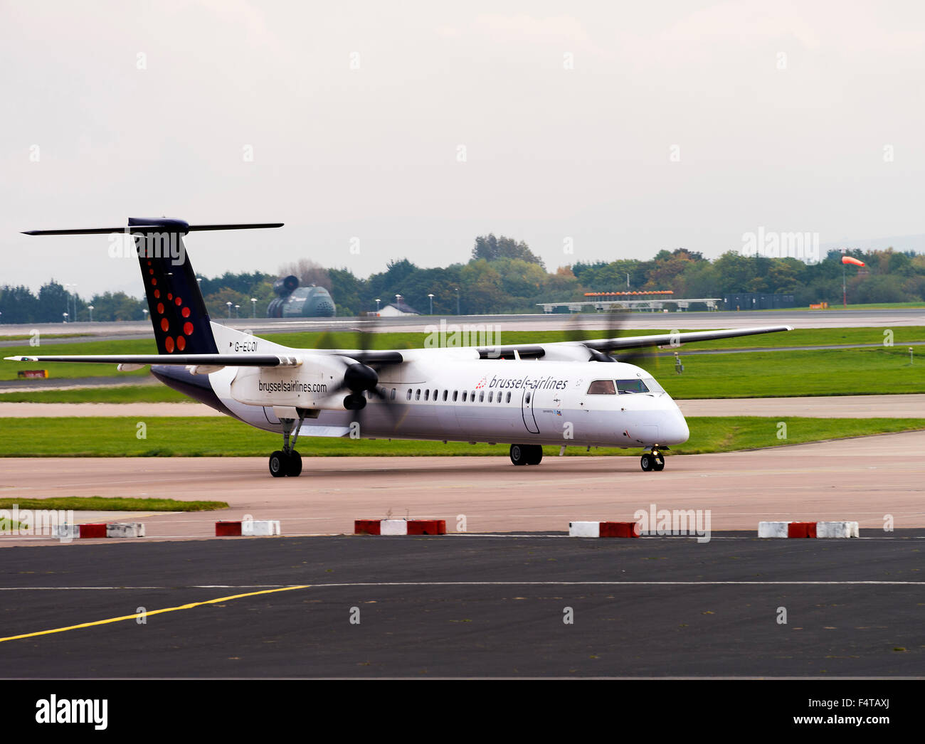 Brussels Airlines Bombardier Dash8-402Q Turboprop Airliner G-ECOI Taxiing at Manchester Airport England United Kingdom - Stock Image