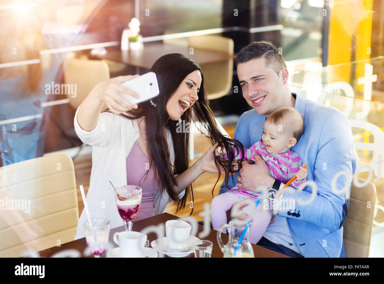 Young family in cafe - Stock Image