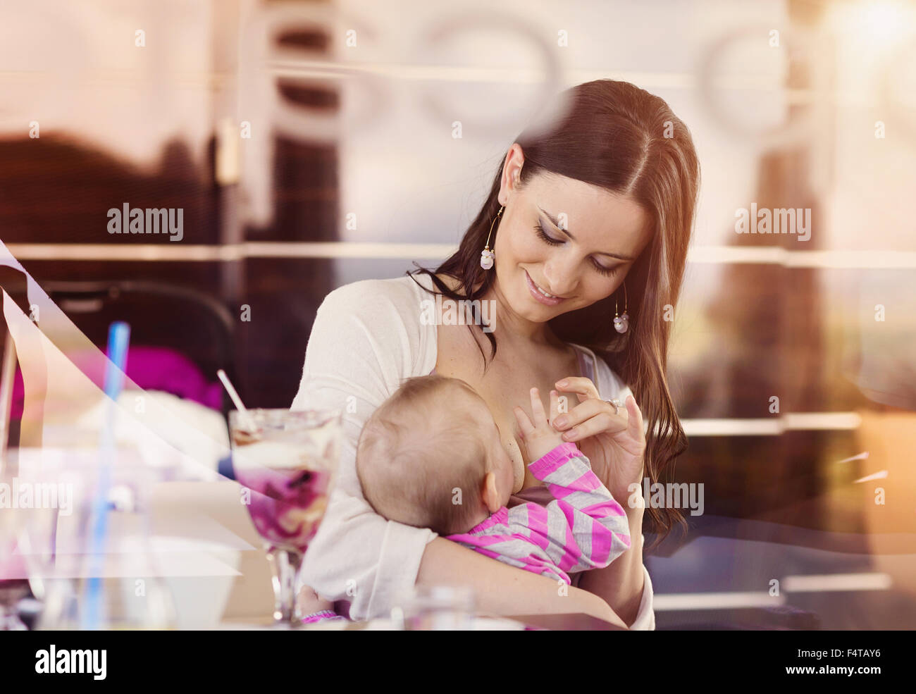 Mother breastfeeding her baby - Stock Image