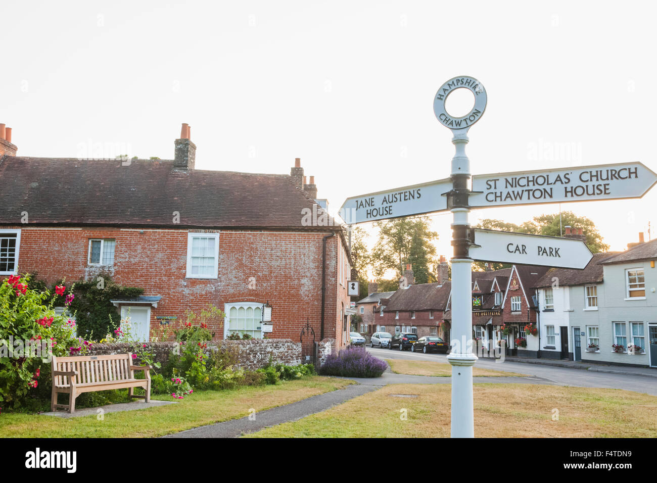 England, Hampshire, Chawton, Road Sign and Jane Austen's House - Stock Image
