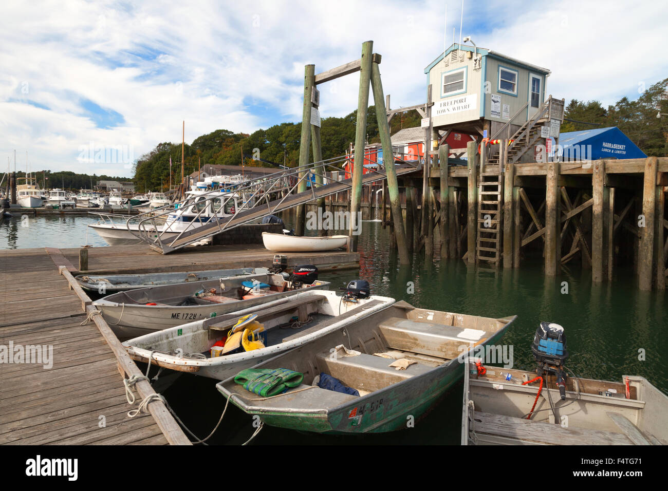 Boats moored in Freeport Harbor on the Harraseeket River, Freeport, Maine USA - Stock Image