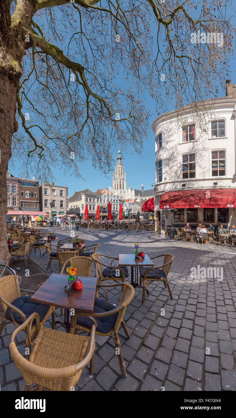 Outdoor cafe's at the Grote Markt square and the bellower of the Grote Kerk Stock Photo