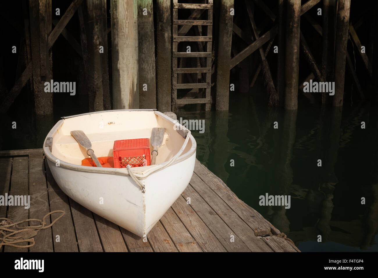A white rowing boat on a jetty, Maine USA - Stock Image