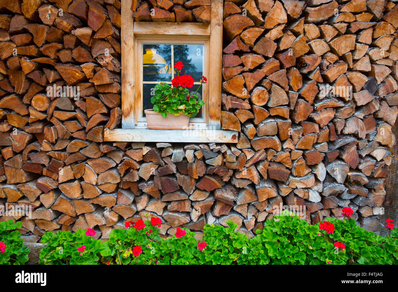 Window with floral decoration in Engadin, - Stock Image