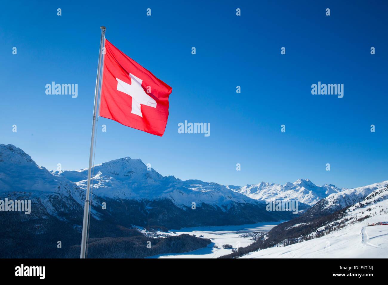 Swiss flag over Engadin, - Stock Image