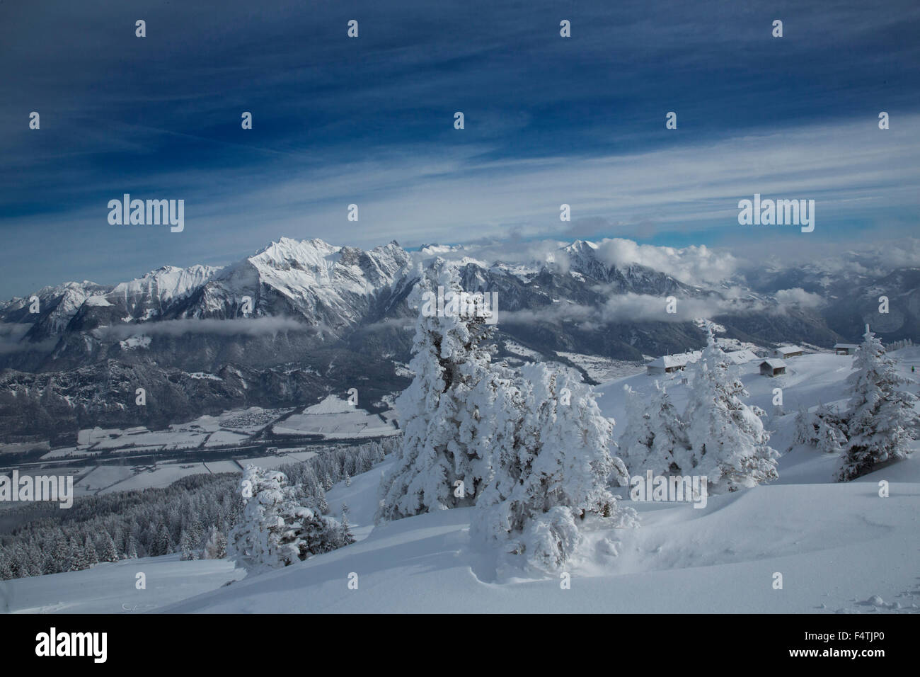Winter scenery in Pizol with Rhine Valley and Grisons mountains, - Stock Image