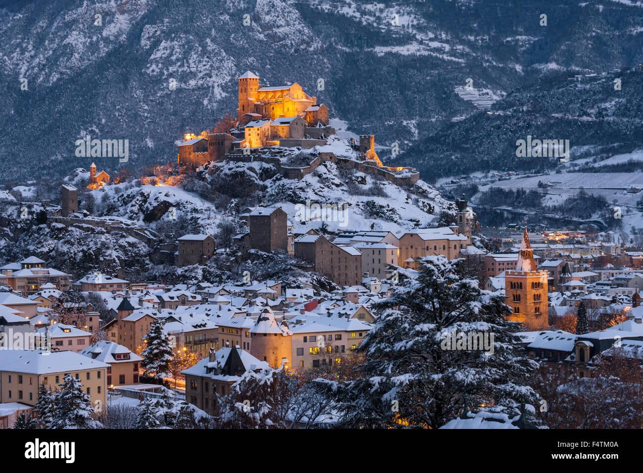 Sion, customs, Switzerland, canton, Valais, town, city, canton capital, Valeria, dusk, lights, illumination, winter - Stock Image