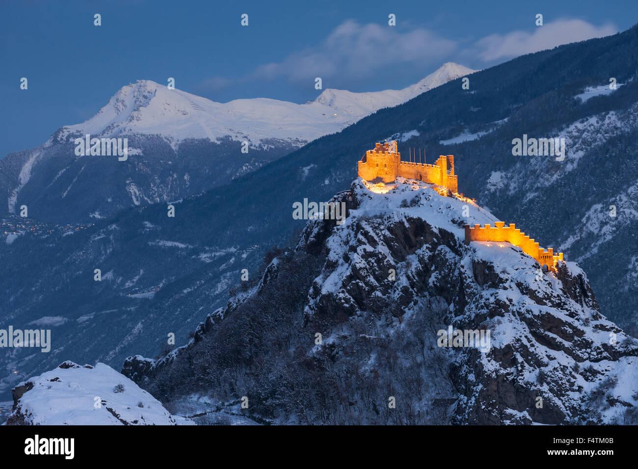 Sion, customs, Switzerland, canton, Valais, town, city, canton capital, Tourbillon, dusk, lights, illumination, - Stock Image