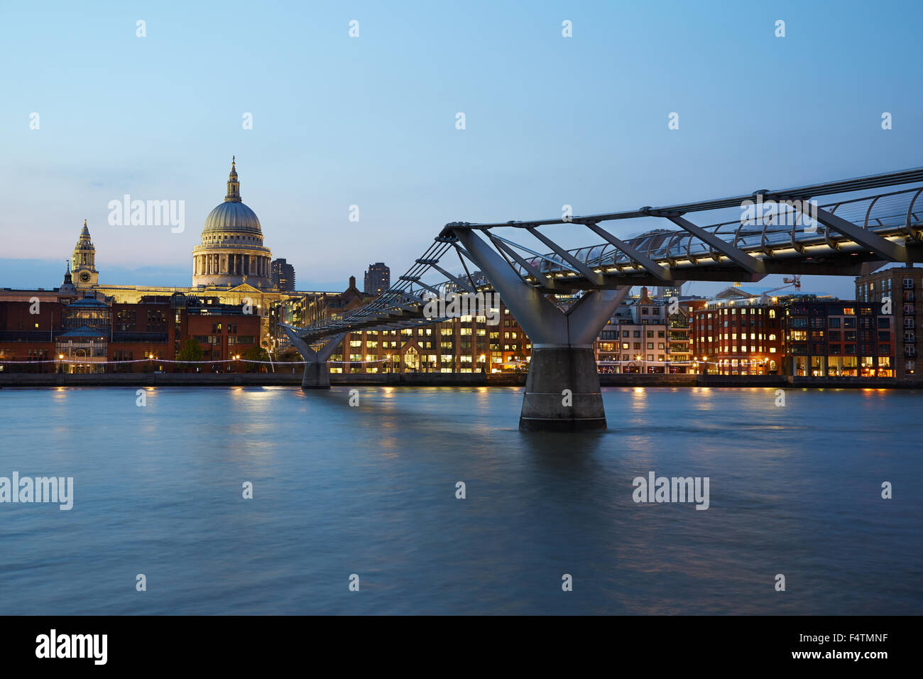 St Paul's Cathedral and Millennium bridge in London at night, natural colors - Stock Image