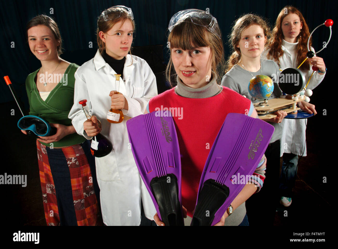 Five students at Rednock School,Dursley,Gloucestershire,UK,represent careers in chemistry,travel,sport,geography - Stock Image