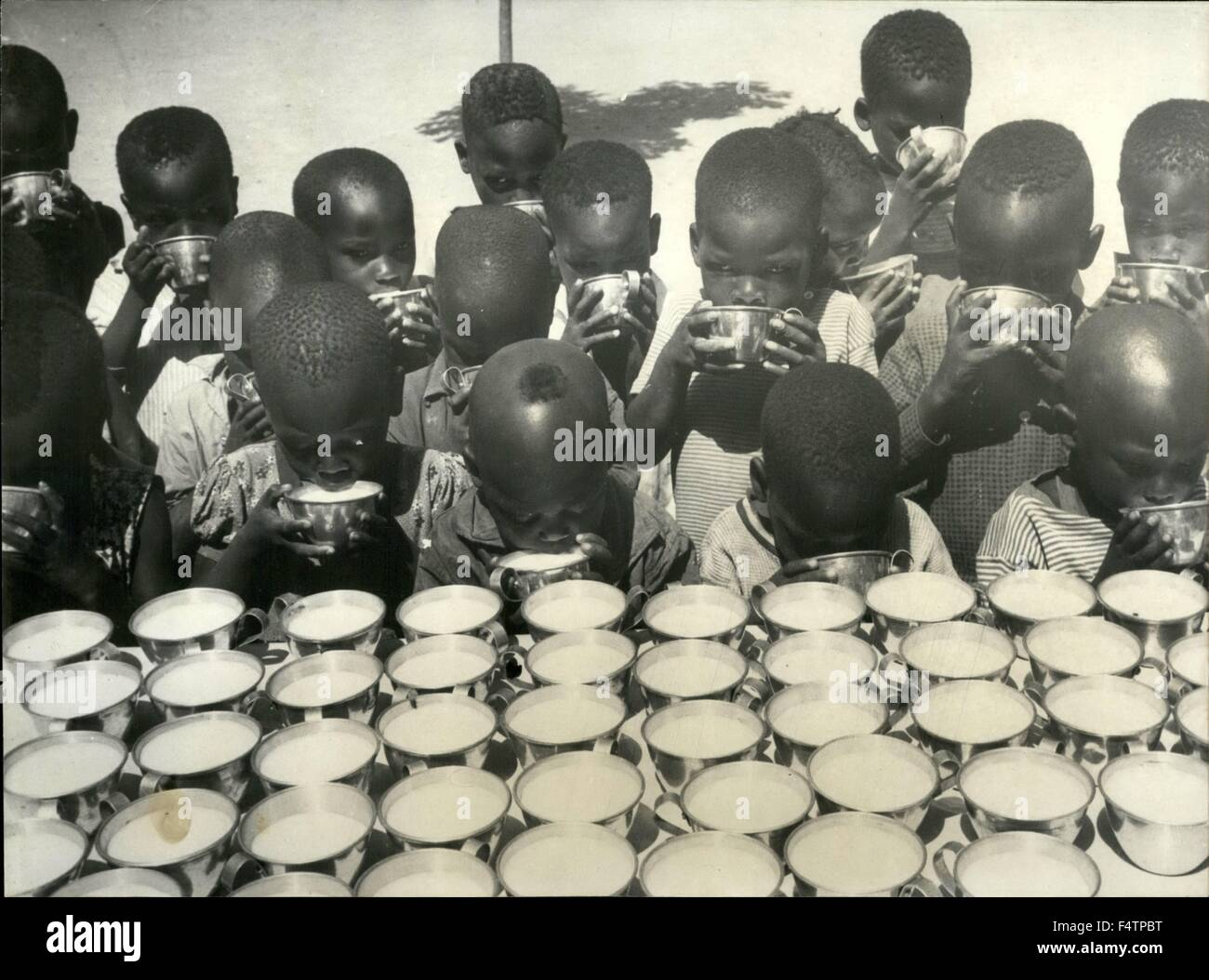 1963 - Photo Shows Undernourished children from Moundow (Tchad, Africa) drinking milk supplied by one of the UNICEF - Stock Image