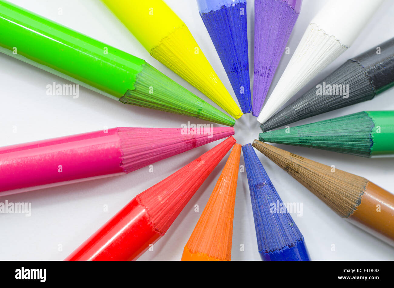Woodless Colored Pencil Heads Arranged in Circle Macro Closeup - Stock Image