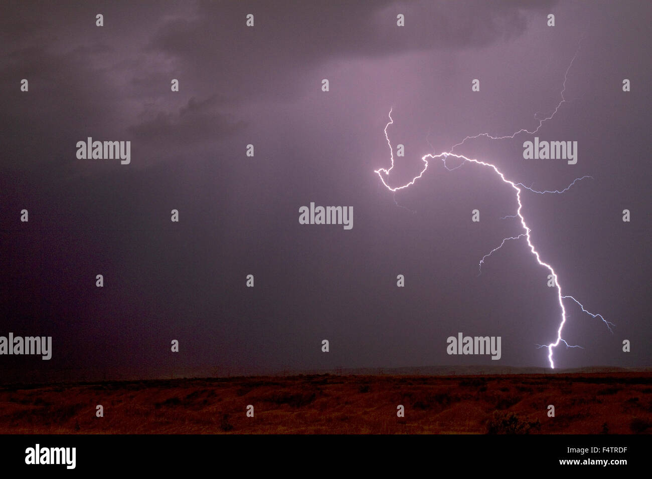 Lightning strike in the sky above Boise, Idaho, USA. - Stock Image