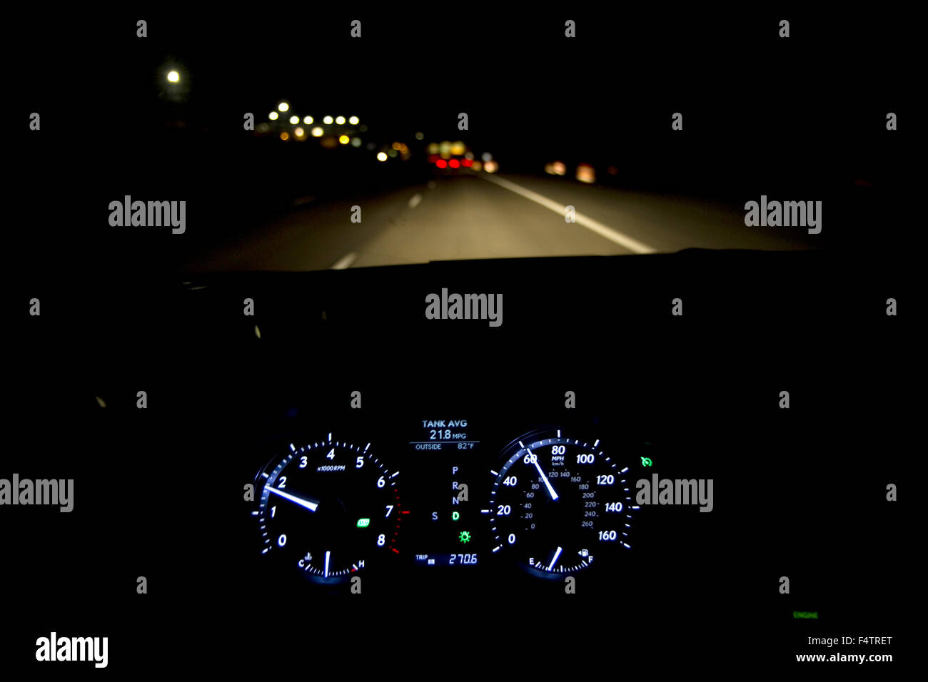 Driver's eye view of dashboard and highway at night in Ada County, Idaho, USA. - Stock Image
