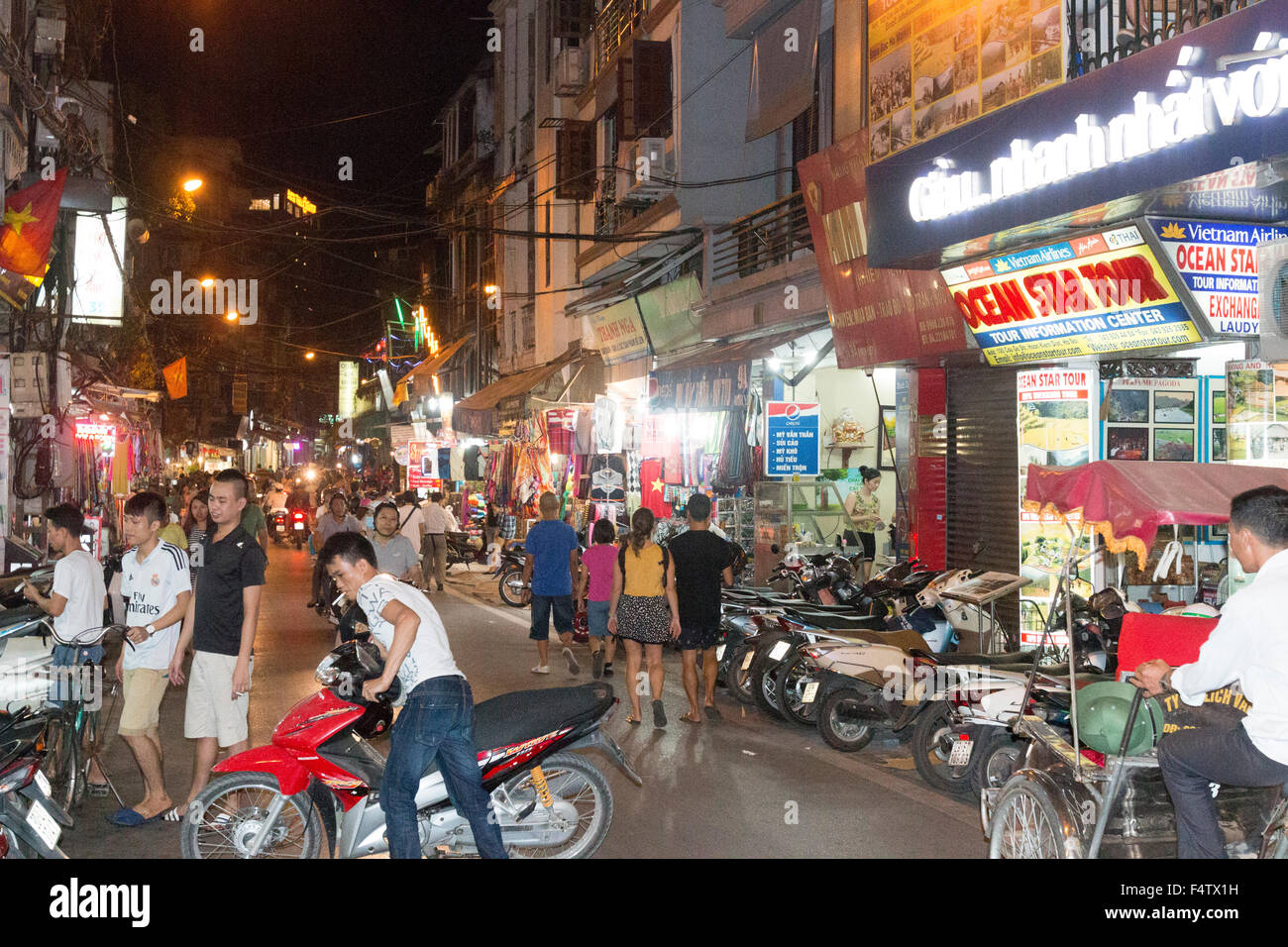 packed and busy streets of Hanoi old quarter in the city centre, favourite spot for locals and tourists each nighttime,Vietnam - Stock Image