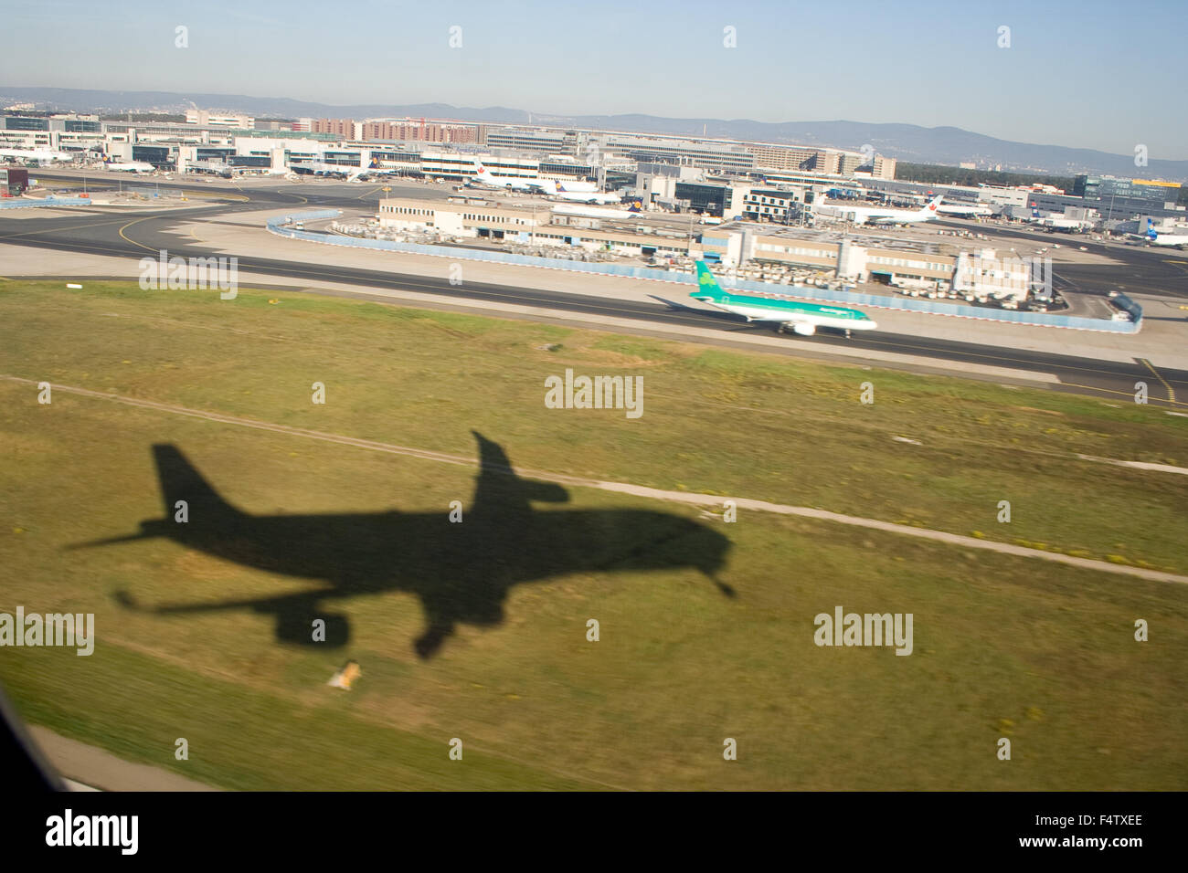 Leaving on a jet plane, the shadow of our plane as seen from the window of the plane, at take-off from the Franfurt - Stock Image