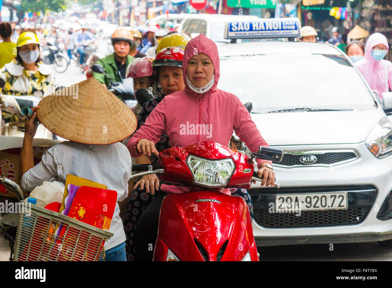 traffic congestion bikes and cars in Hanoi old quarter, city centre,Vietnam Stock Photo