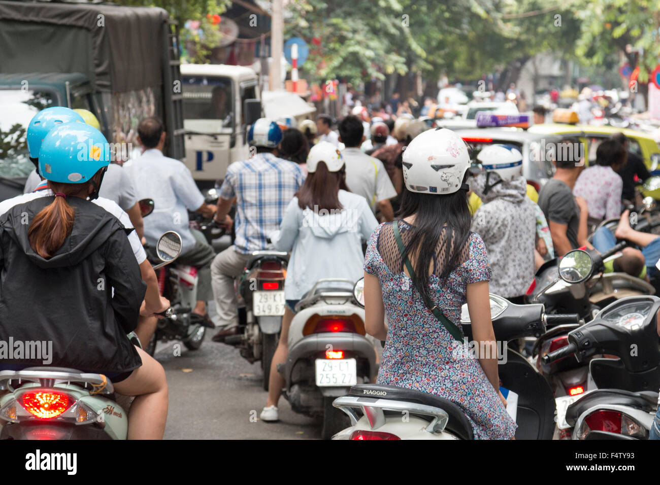 traffic congestion bikes and cars in Hanoi old quarter, city centre,Vietnam - Stock Image