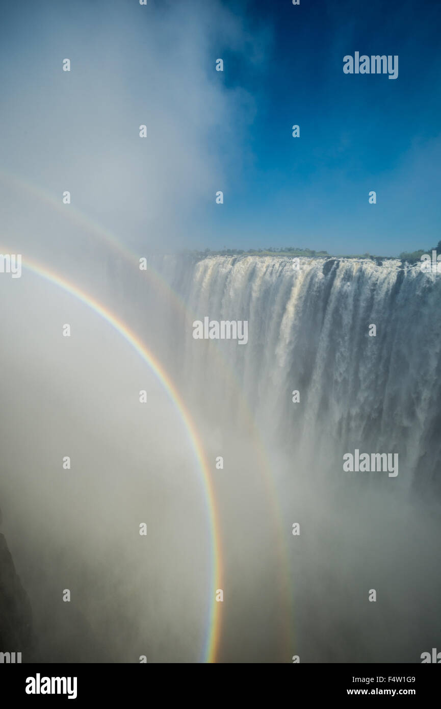 Victoria Falls, Zimbabwe - Victoria Falls Waterfall with rainbow - Stock Image