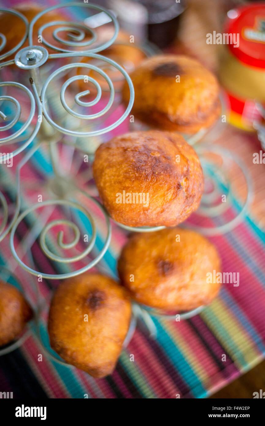 Kasane, Botswana - Muffins on decorative rack. - Stock Image