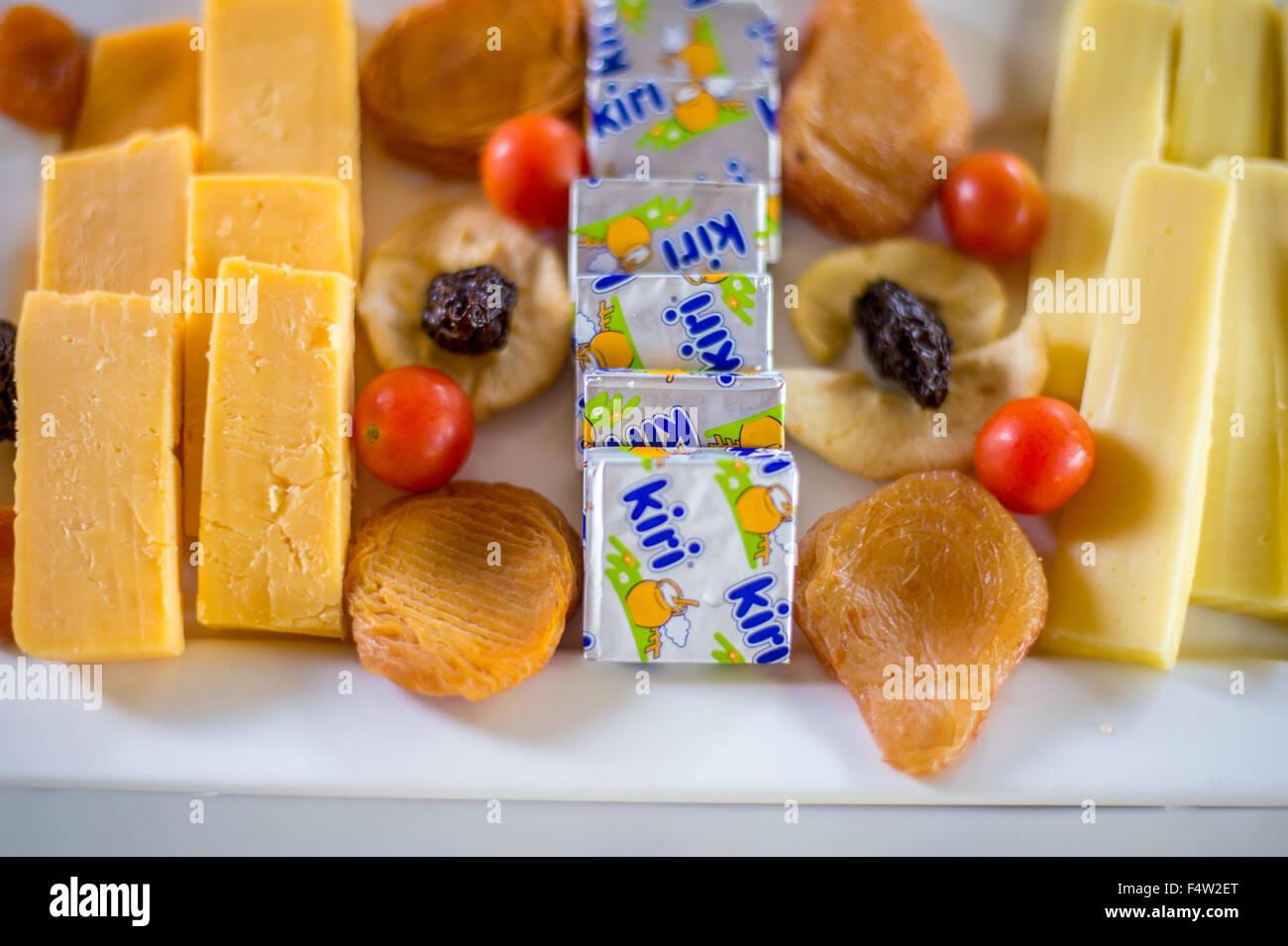 Kasane, Botswana - Plate of cheese, dried fruit and kiri. - Stock Image