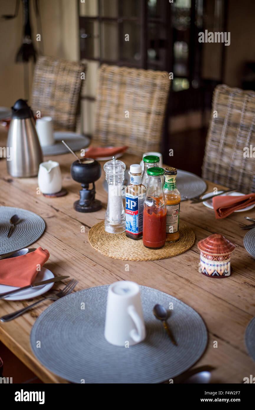 Kasane, Botswana - Condiments on dinner table. - Stock Image