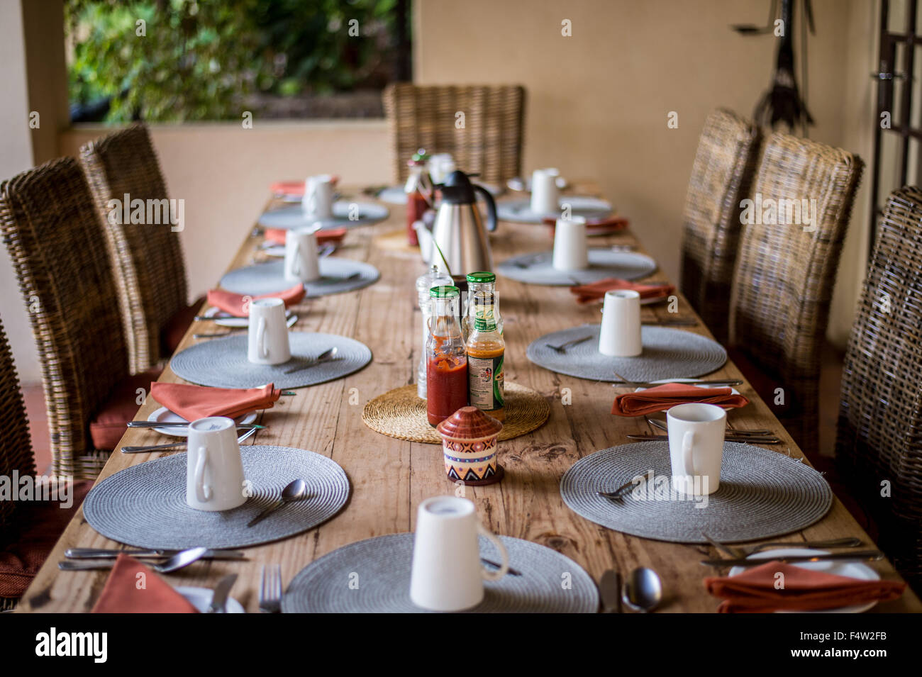Kasane Botswana - Large dinner table set up with coffee cups & Kasane Botswana - Large dinner table set up with coffee cups Stock ...