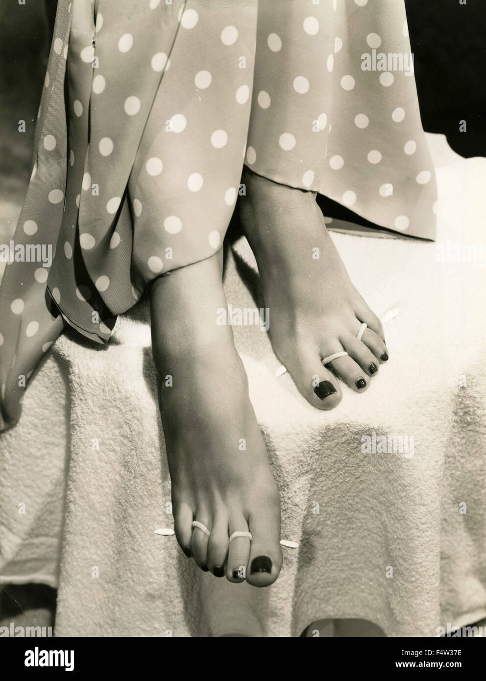 A Model Has Put The Polish On The Nails Of The Toes Stock Photo