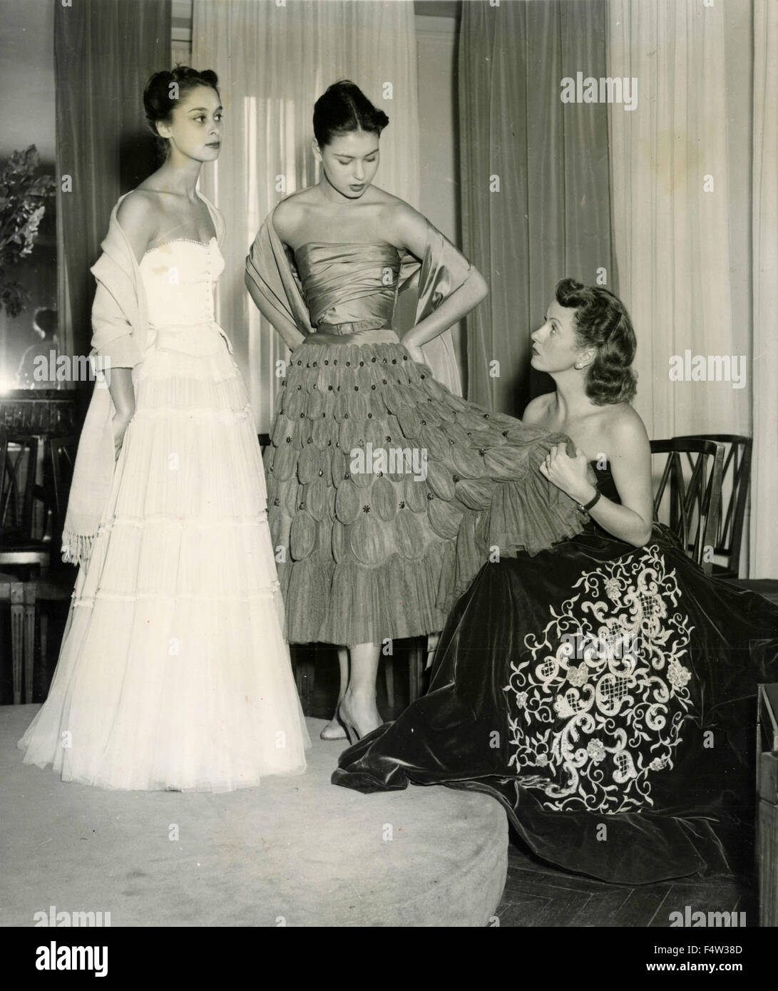 b052cf2d The French actress Danielle Darrieux observes the clothes prepared for her  by fashion designer Pierre Balmain