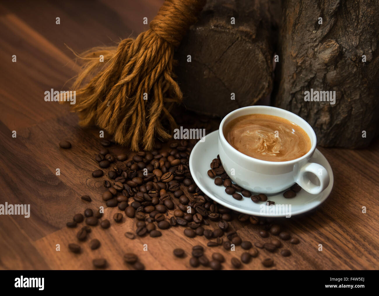Cup of coffee with beans in earthy setting - Stock Image