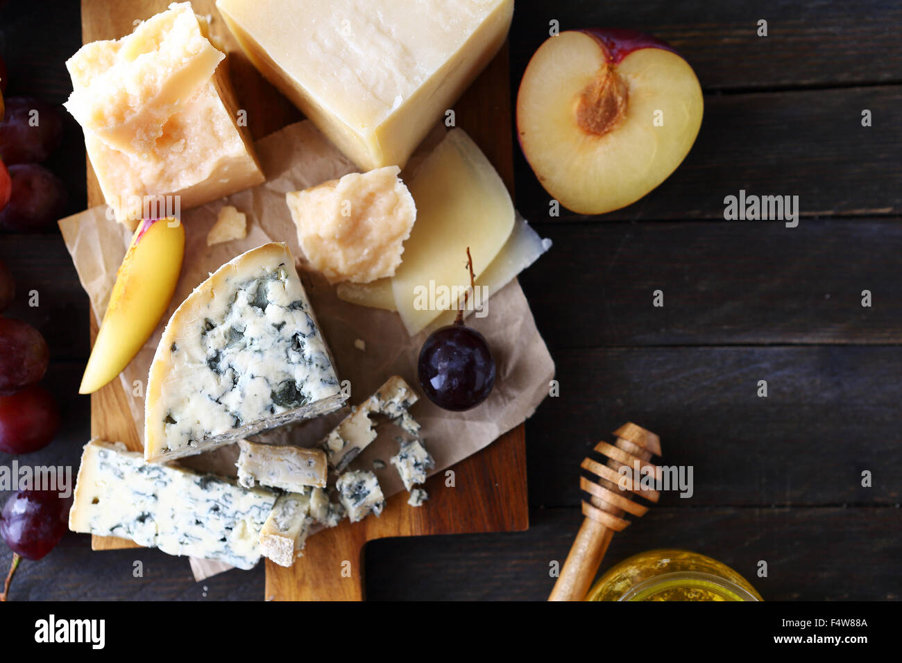 cheese with fruits for appetizer, top view - Stock Image