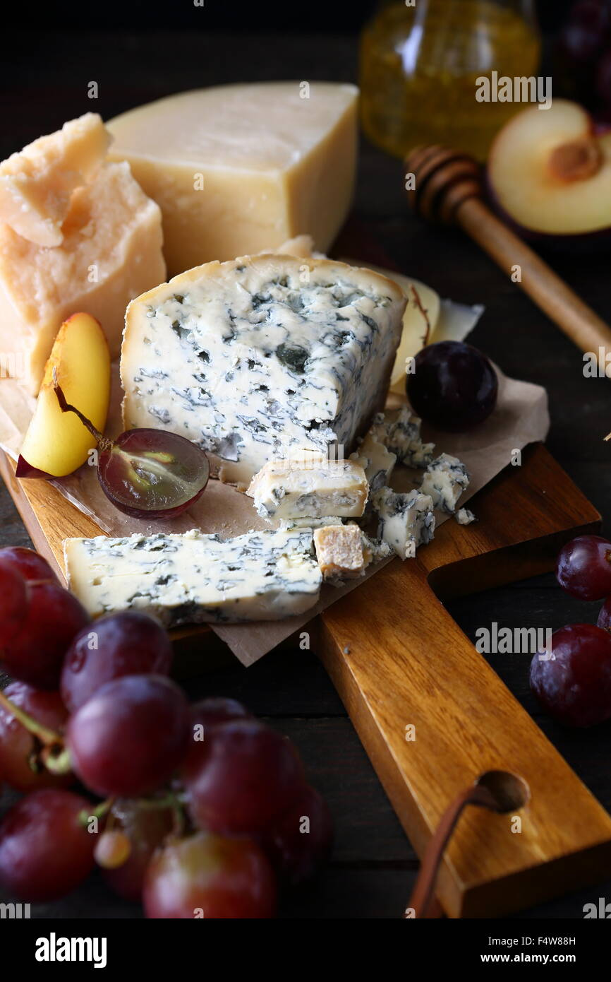 cheese roquefort and grapes, dairy product - Stock Image
