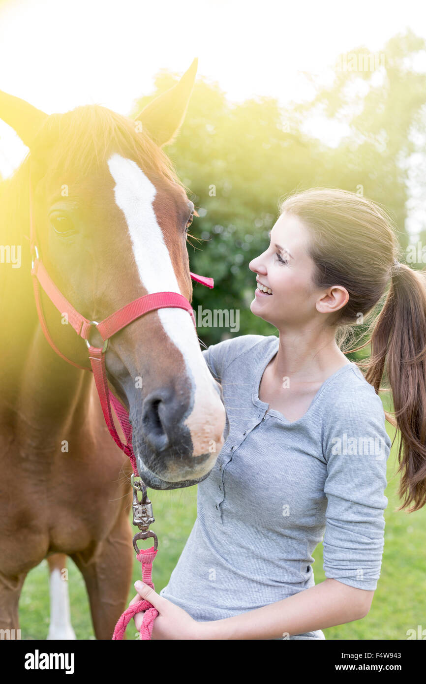 Smiling woman with horse - Stock Image