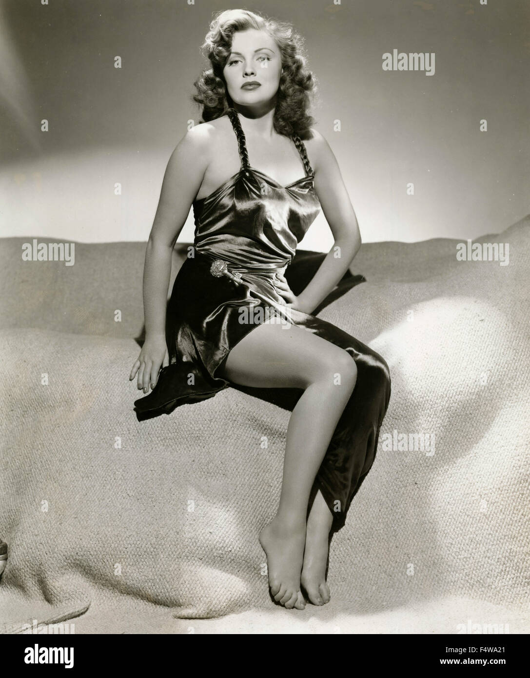 The American actress Joan Leslie wears a silk dress - Stock Image
