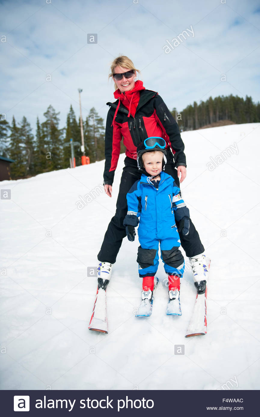 Mother and son skiing - Stock Image